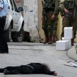 Abed al-Fattah Yusri al-Sharif, 21, lying dead in the street in Hebron, March 24, 2016