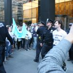 Police bring an IfNotNow protester from the lobby of the offices of the Anti Defamation League in New York. (Photo: Wilson Dizard)