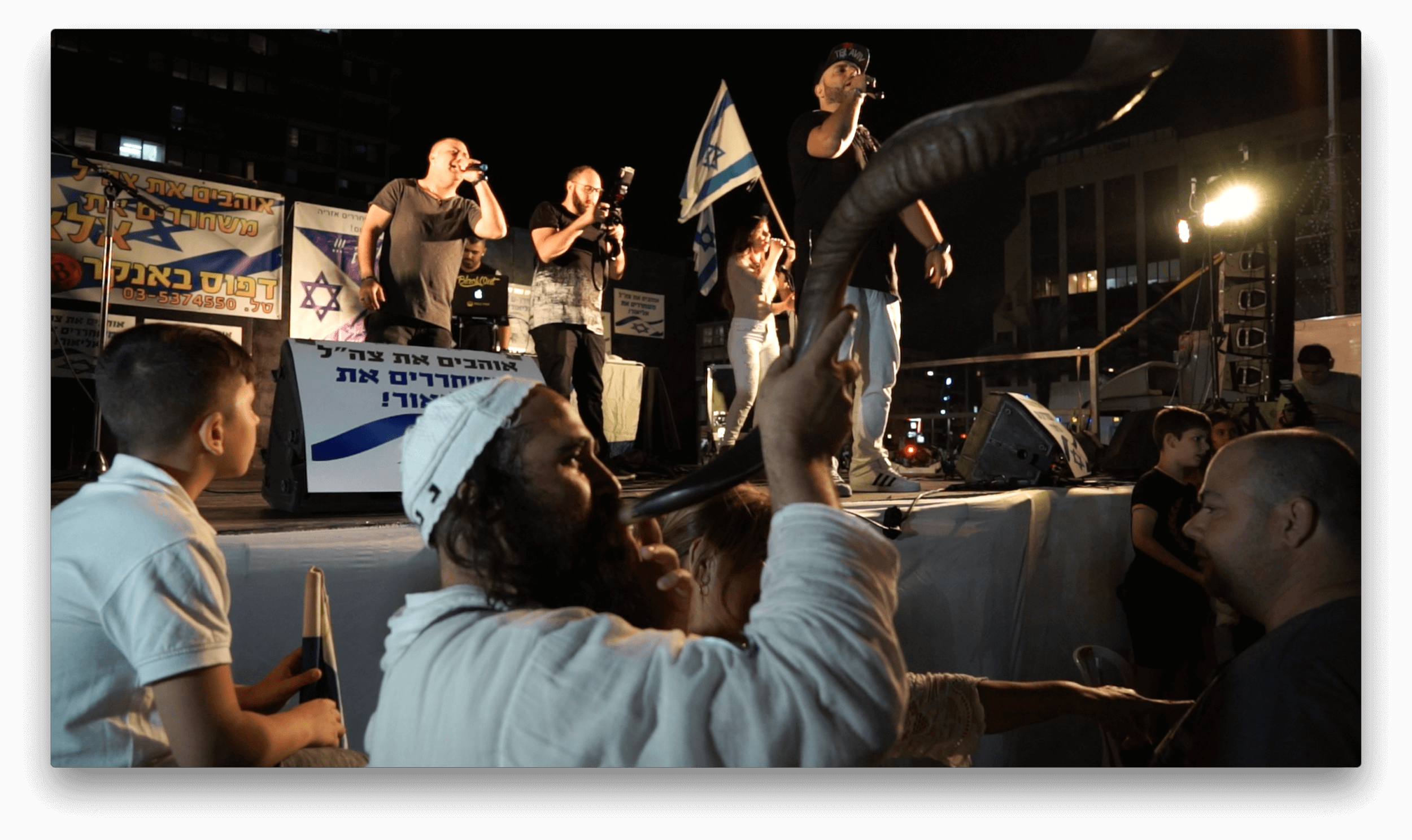 Right-wing rapper Subliminal and a Brestlev man blowing a shofar during the rally in Tel Aviv for soldier-executioner Elor Azarya