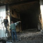 Palestinian assess damage to a West Bank shop burned beyond repair in a fire started by the Israeli military, al-Bireh. (Photo: Allison Deger)