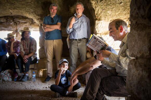 RAMALLAH, PALESTINE - MAY 22: Raja Shehadeh reads to festival participants during a walk in hills on the outskirts of Ramallah on May 21, 2016 in Ramallah, Palestine. (Rob Stothard for The Palestine Festival of Literature)