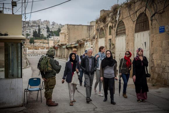 HEBRON, PALESTINE - MAY 24: Festival participants walk through an area of the city inhabited by Israeli settlers on May 24, 2016 in Hebron, Palestine. (Rob Stothard for The Palestine Festival of Literature)