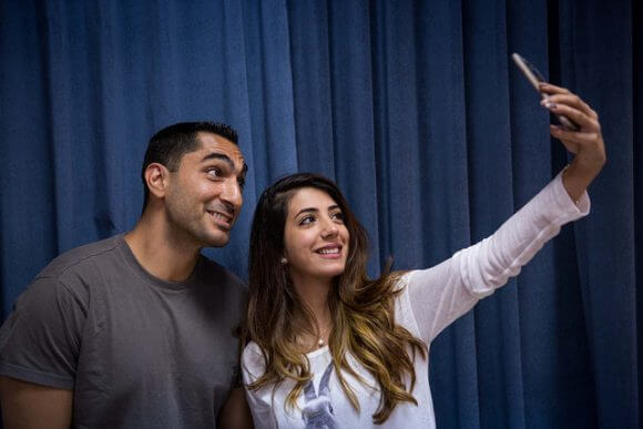 BETHLEHEM, PALESTINE - MAY 23: Festival participant Remi Kanazi poses for a selfie with a student at Bethlehem University on May 23, 2016 in Bethlehem, Palestine. (Rob Stothard for The Palestine Festival of Literature)