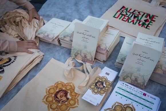 RAMALLAH, PALESTINE - MAY 21: A table of merchandise for sale at the opening event of the annual Palestine Festival of Literature at The Ottoman Court on May 21, 2016 in Ramallah, Palestine. (Rob Stothard for The Palestine Festival of Literature)