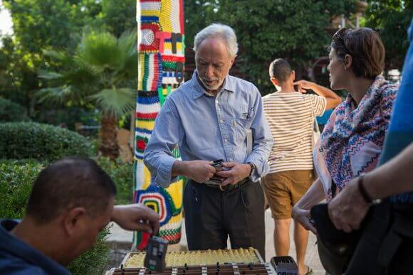 NABLUS, PALESTINE - MAY 25: Festival participant J.M. Coetzee takes a set of headphones at a public event in the Municipal Library Gardens on May 25, 2016 in Nablus, Palestine. (Rob Stothard for The Palestine Festival of Literature)