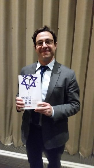 Dov Waxman, with his book, Trouble in the Tribe