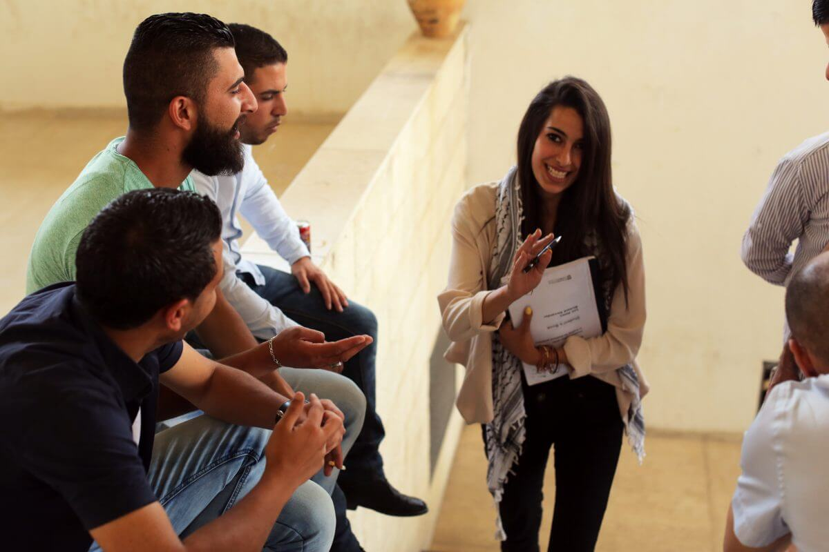 Dana Rwaidy meets with some of her classmates, several of whom are also in student government. (Photo: Abed al Qais)