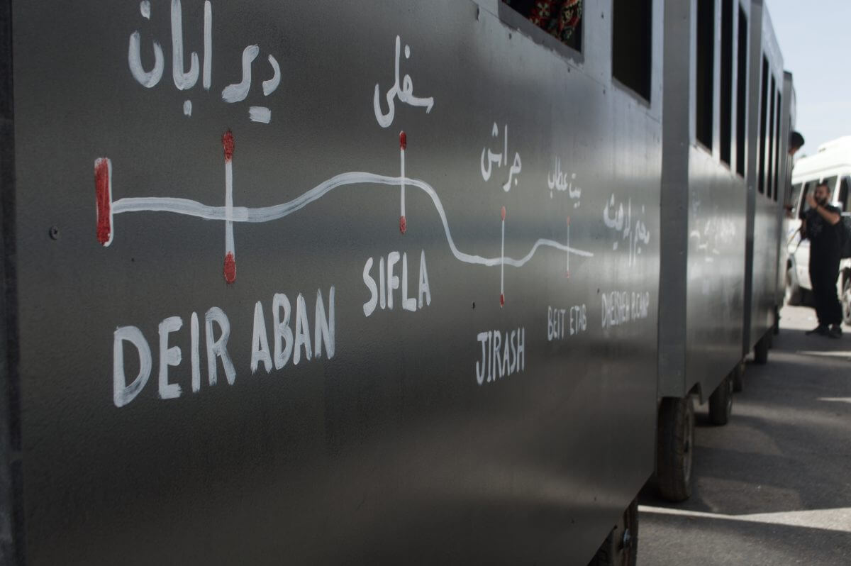 Each cart of the train had names of Palestinian refugee camps in the occupied West Bank, and the names of the cities many of the residents originally hailed from. (Photo by Sheren Khalel)