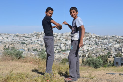 Children fly a kite, on Tel Rumeida, photo by David Kattenburg