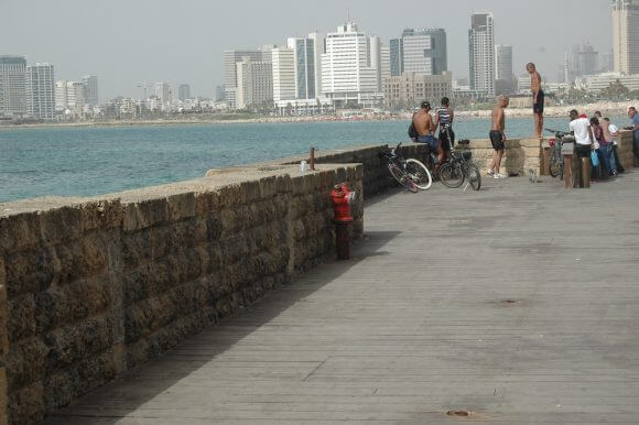 Youth jump from the sea wall at north end of the Jaffa Port into the Mediterranean Sea. (Photo: Allison Deger)