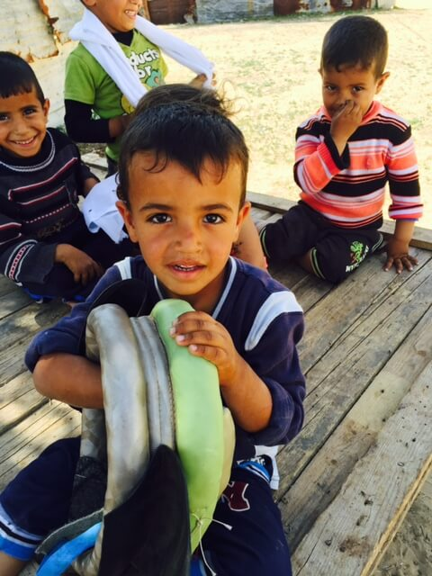 Children near the sewage lake at Umm al-Nasser (photo Nancy Murray, April 20)