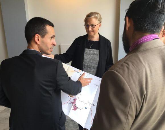 Ahmad al Atrash explains West Bank planning to Sri Kularni of Sen. Kirsten Gillibrand's office. Donna Baranski-Walker at center