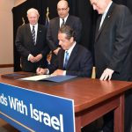 Gov. Cuomo signs anti-BDS executive order. At center is Ido Aharoni, Israeli consul. On right is Malcolm Hoenlein, head of the Conference of Presidents of Major Jewish Organizations, an Israel lobby group.