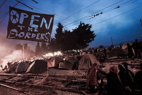 Refugees at Idomeni plea to have the Macedonian border opened. (Photo: Hala Gabriel)