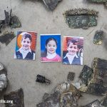 Photos of the three Shuheibar children amid fragments of the missile that killed them. The children, Jehad (10) Afnan (8) , and Wassim (9 ),  were killed July 17, 2014 by a missile fired from an Israeli drone while they were playing on the roof of their home. (Photo: Anne Paq)