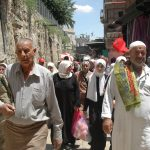 Palestinians worshippers walk through the Muslim Quarter after Friday prayers during the month of Ramadan, Jerusalem. (Photo: Allison Deger)