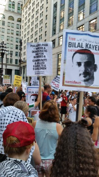 Bilal Kayed posters at City Hall demonstration, July 26