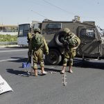 Israeli security forces gather near the scene of what the Israeli military said was an attack by Palestinian in the Jewish settlement of Kiryat Arba near the West Bank city of Hebron 30 June 2016. Israeli army said the Palestinian was shot and killed after he stabbed and killed an Israeli female settler and injured others. (Photo: Wisam Hashlamoun/APA Images)