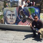 White nationalist intellectual Richard Spencer posing in front of a mural of Donald Trump outside the RNC. (Photo: Dave Weigel/Twitter)