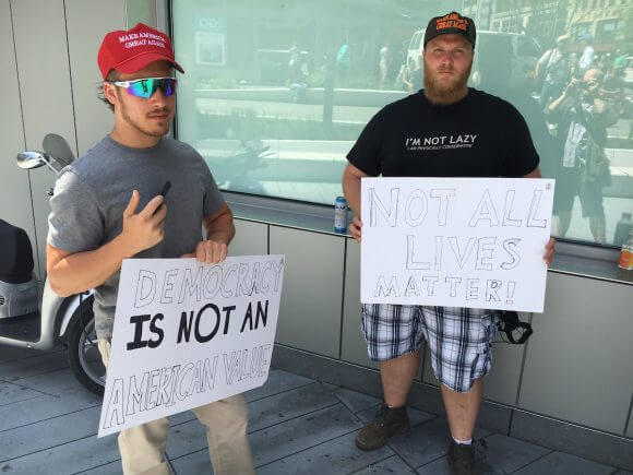 Eli, 32, from Alaska, and Austin, 23, from Cleveland, at the RNC. (Photo: Wilson Dizard)