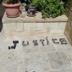 """""""Justice"""" spelled out in coated bullets used by Israeli Defense Forces against demonstrators around the wall in Bethlehem. (Photo: Harry Gunkel)"""