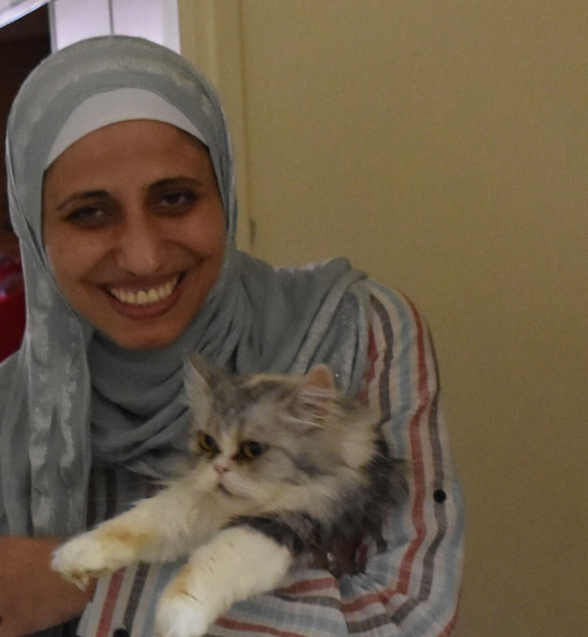 Dareen Tatour with one of her cats. (Photo: Zahi Khamis)