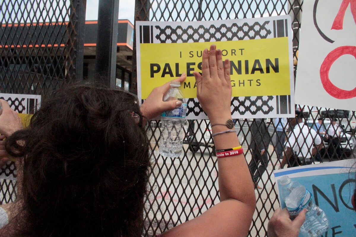 A protester holds up a sign for Palestinian rights at the Democracy Rising protest outside the Democratic National Convention in Philadelphia.(Photo: Wilson Dizard)