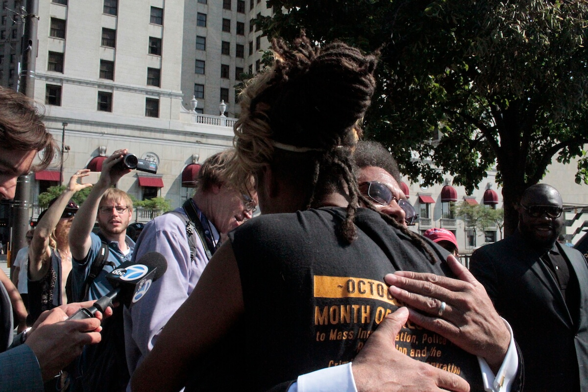 Cornel West hugging a supporter. (Photo: Wilson Dizard)