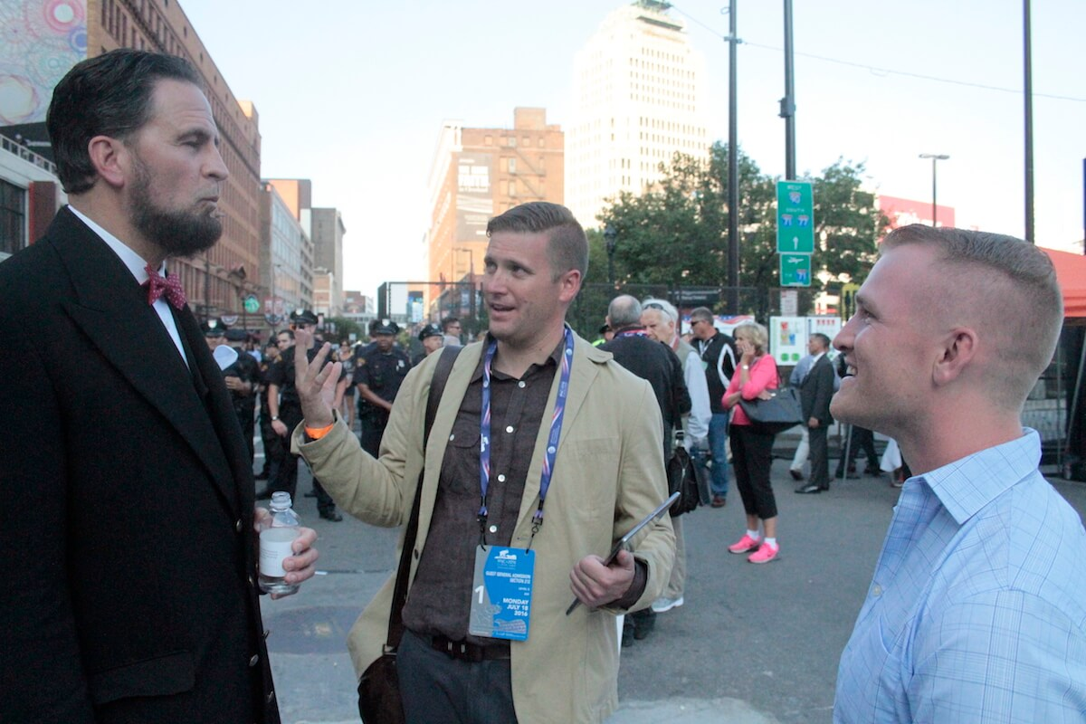 Richard Spencer, and friend Nathan Damigo at right, debate with an Abraham Lincoln impersonator outside the RNC. (Photo: Wilson Dizard)
