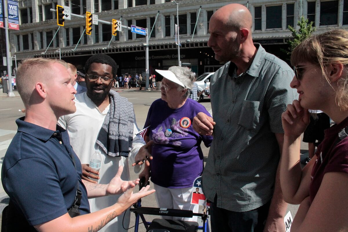 (From left to right) Nathan Damigo, a follower of the Alt-Right,' Abdel Wudud, Erica, Mohamed Abdelaziz and Galina Abdelaziz discussing race and politics outside the RNC in Cleveland. (Photo: Wilson Dizard)