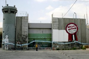 Palestinian boys walk beside the controversial Israeli barrier in the West Bank town of Bethlehem on July 6 2009. (Photo: Najeh Hashlamoun/APA Images)
