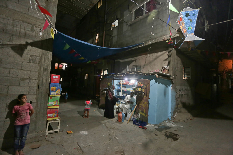 Ola Matar, 11, stares at Ramadan lantern in a refugee camp in Gaza, June 27, 2016. (Photo: Mohammed Asad)