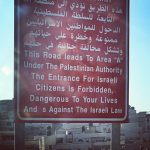 An Israeli road sign in the occupied West Bank. (Photo: Laila Abdelaziz)