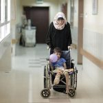 A mother and son in the orthopedic department at Ash Shifa hospital, Gaza City, October 2015 (Photo: UN/OCHA)