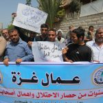 Palestinian workers demonstrate against the Israeli blockade of the Gaza Strip during a rally marking May Day, on May 1, 2016, in Gaza City. Israel has maintained a blockade of Gaza since 2006, and recently banned the supply of cement and construction materials for the private sector, citing security concerns. (Photo: Mohammed Asad/ APA Images)