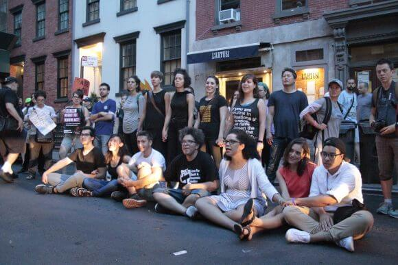 Seven activists block W. 10th Street outside NY's 6th Precinct, August 11, 2016, before arrest. Photo by Wilson Dizard