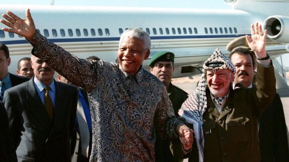 Freedom fighters: Nelson Mandela greeted by Yasser Arafat in Gaza. Reuters photo.