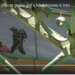Screen shot of video recorded by B'Tselem field researcher Manal al-Ja'bri, showing an Israeli soldier throwing an 8-year old Palestinian girl's bicycle into bushes. (Video: B'tselem)