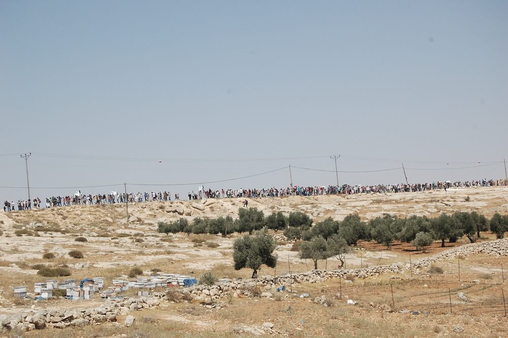 Hundreds of Israelis join Palestinians in Susiya for a protest against the village's demolition, July 2015 (Photo: Allison Deger)