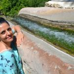 Vivien Sansour at an irrigation channel in Battir