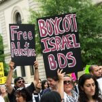 Activists call for boycotting Israel. (Photo via BDSMovement.net)