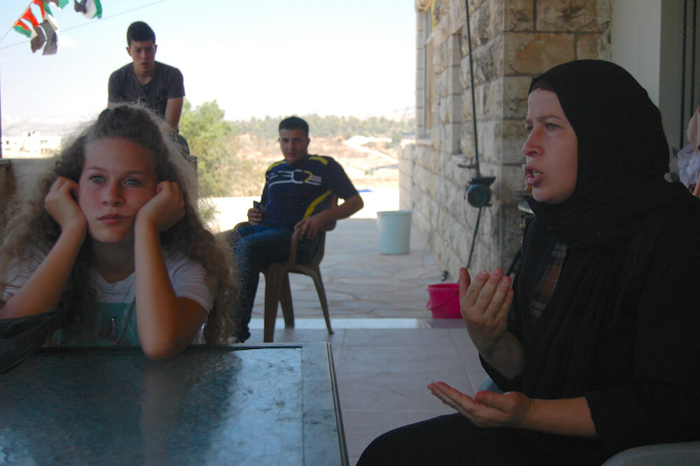 Ahed Tamimi (L) sits with her mother Nairiman Tamimi outside of their family home in Nabi Saleh. (Photo: Allison Deger)