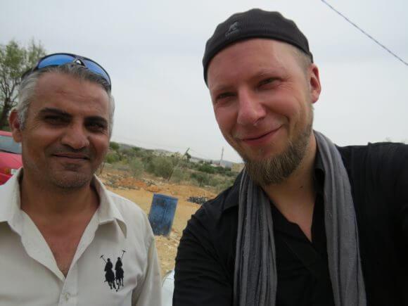 Glanz with filmmaker Emad Burnat in Bil'in