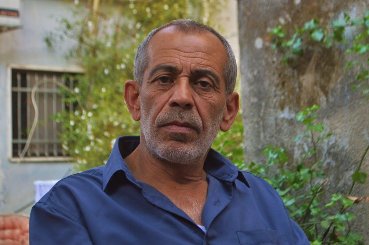 Nasir Abu Ajamia, Ramzi's father, said getting his son proper medical treatment outside of the West Bank has become his family's main priority. (Photo: Sheren Khalel)