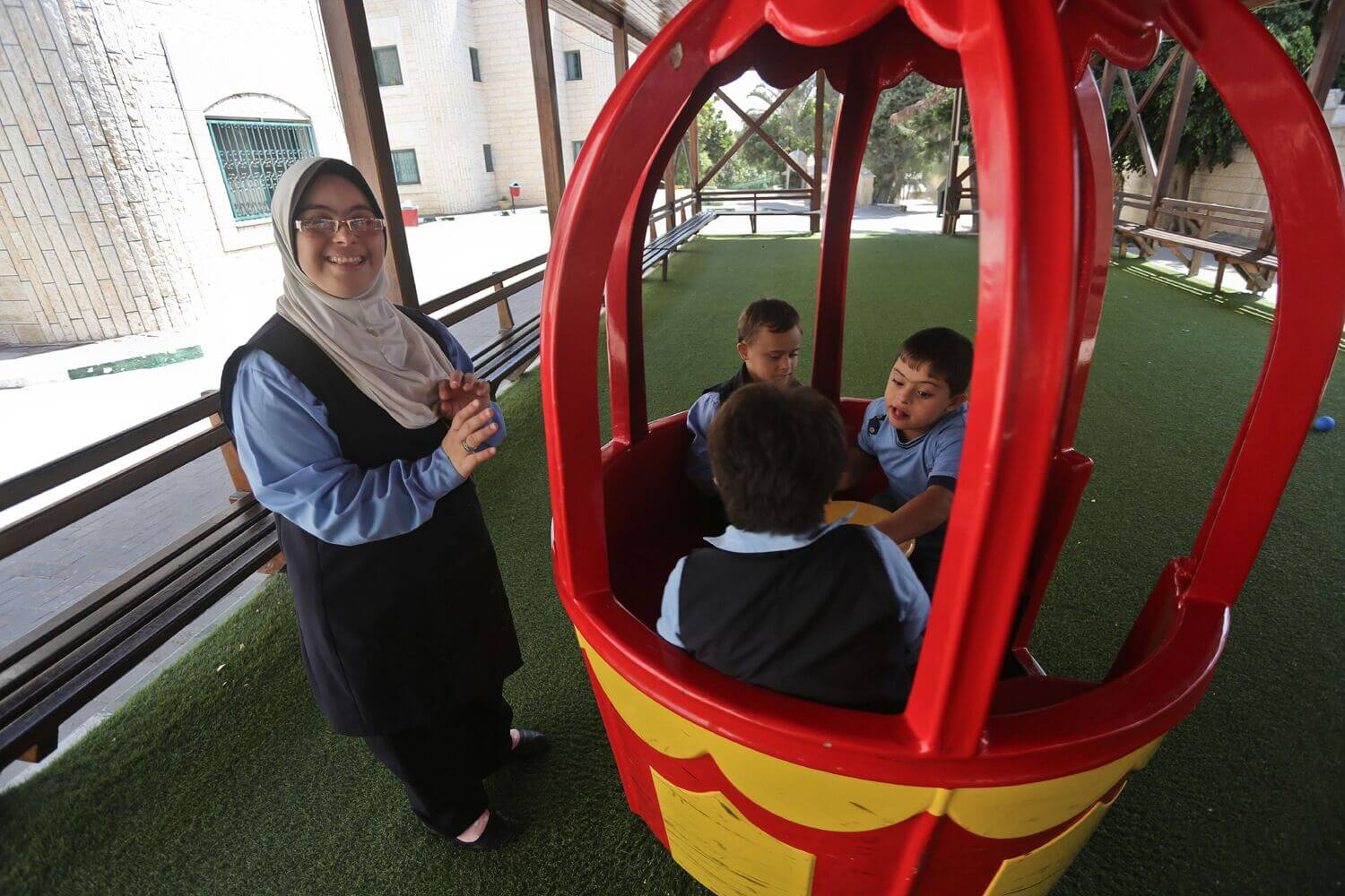 Children playing with Hiba Shurafa during a recess break at the Right to Life Society school in Gaza. (Photo: Mohammed Asad)