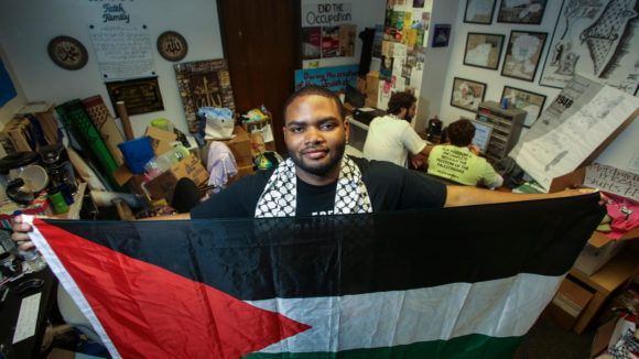 Robert Gardner, a senior at UCLA, stands in the Students for Justice in Palestine office. (Photo: Ringo H.W. Chiu / LA Times)