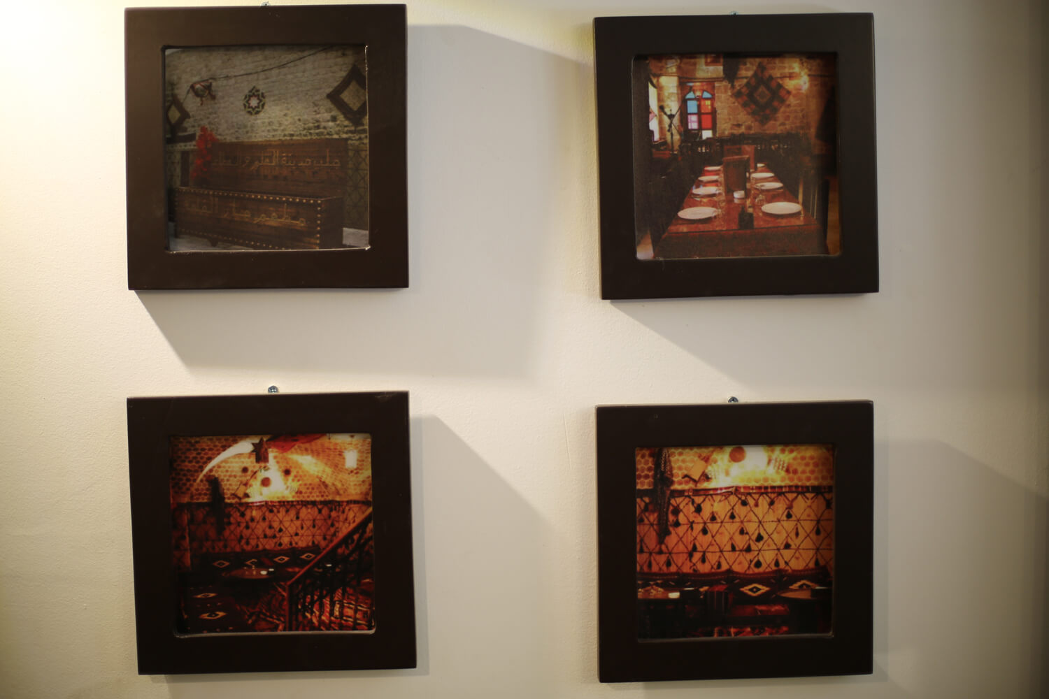 Photos of the destroyed restaurant in Aleppo now displayed in Gaza. (Photo: Mohammed Asad)