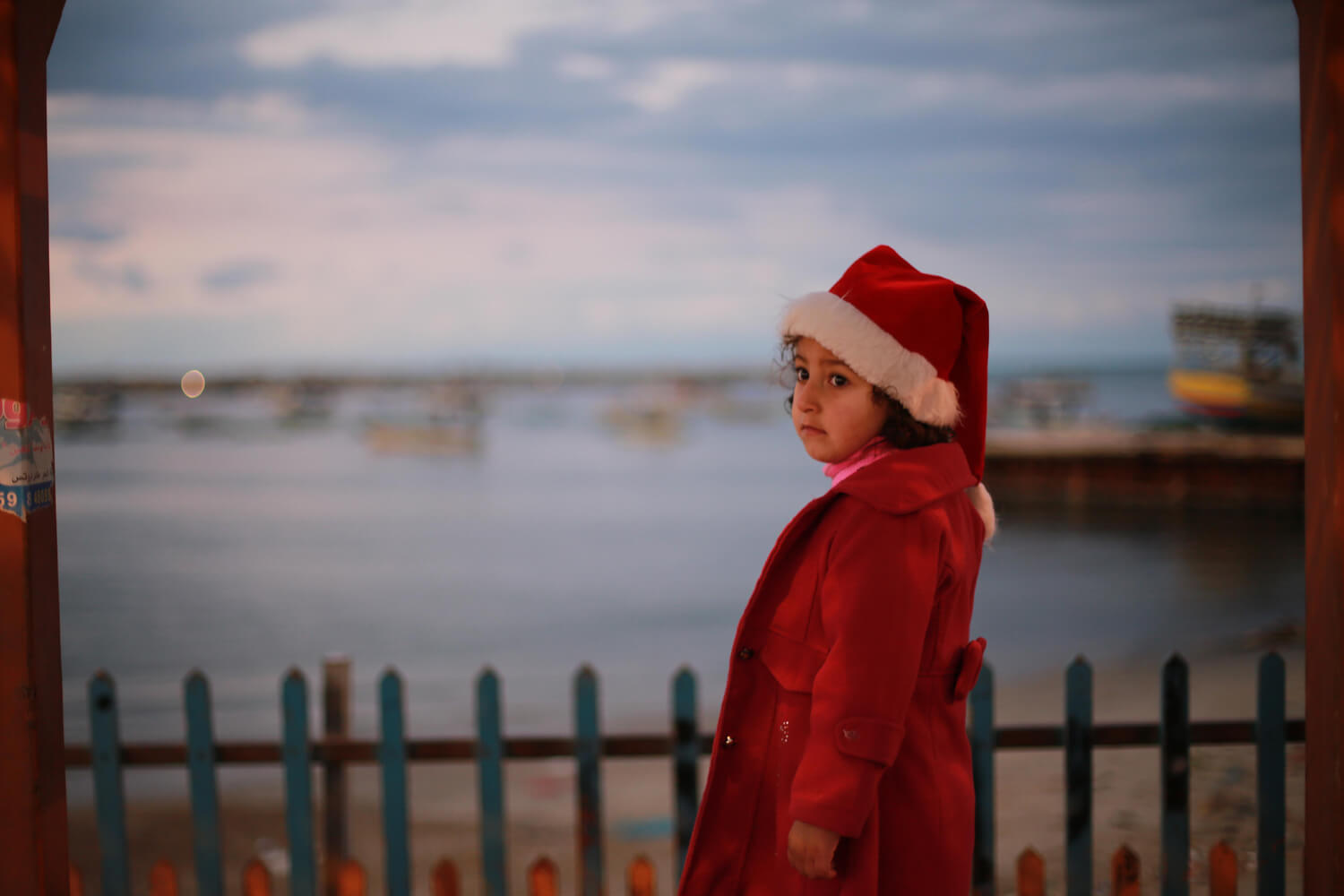 Children dressed as Santa Claus enjoy the Gaza port (Photo: Mohammed Asad)