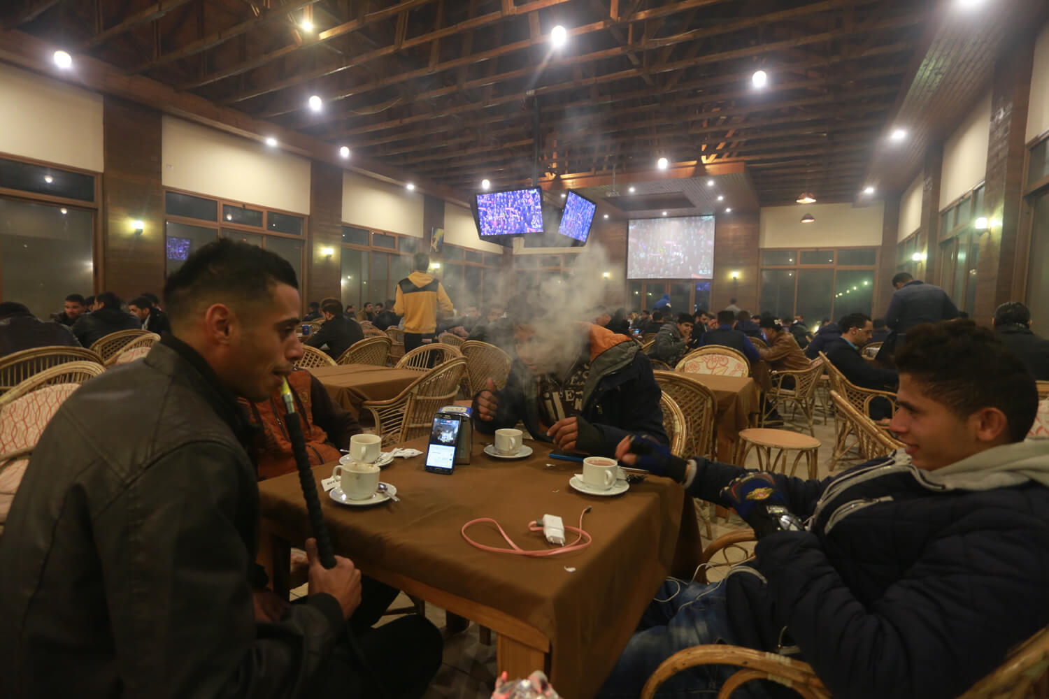Youths spend some quality time in a coffee shop (Photo: Mohammed Asad)
