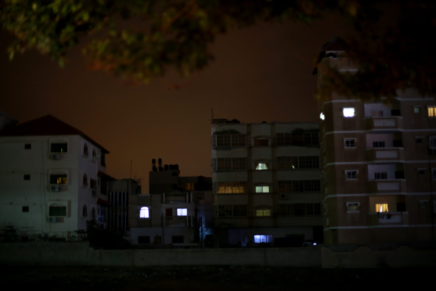Apartments lit by generators during a power outage. (Photo: Mohammed Asad)